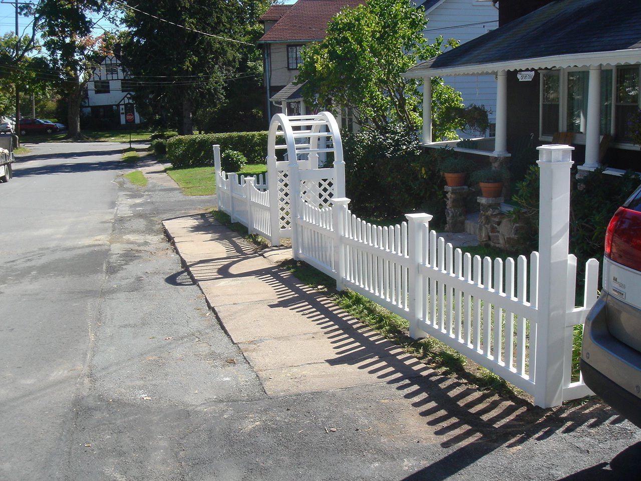 Vinyl Picket Fence With New England Post Caps And Palace Solar Cap On The Corner Posts Grand Arbor Over Opening